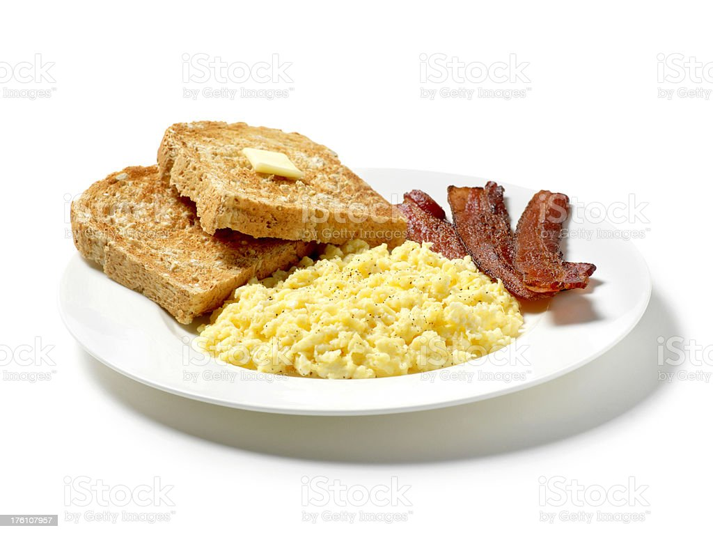Scrambled Eggs with Toast and Sliced Bacon royalty-free stock photo