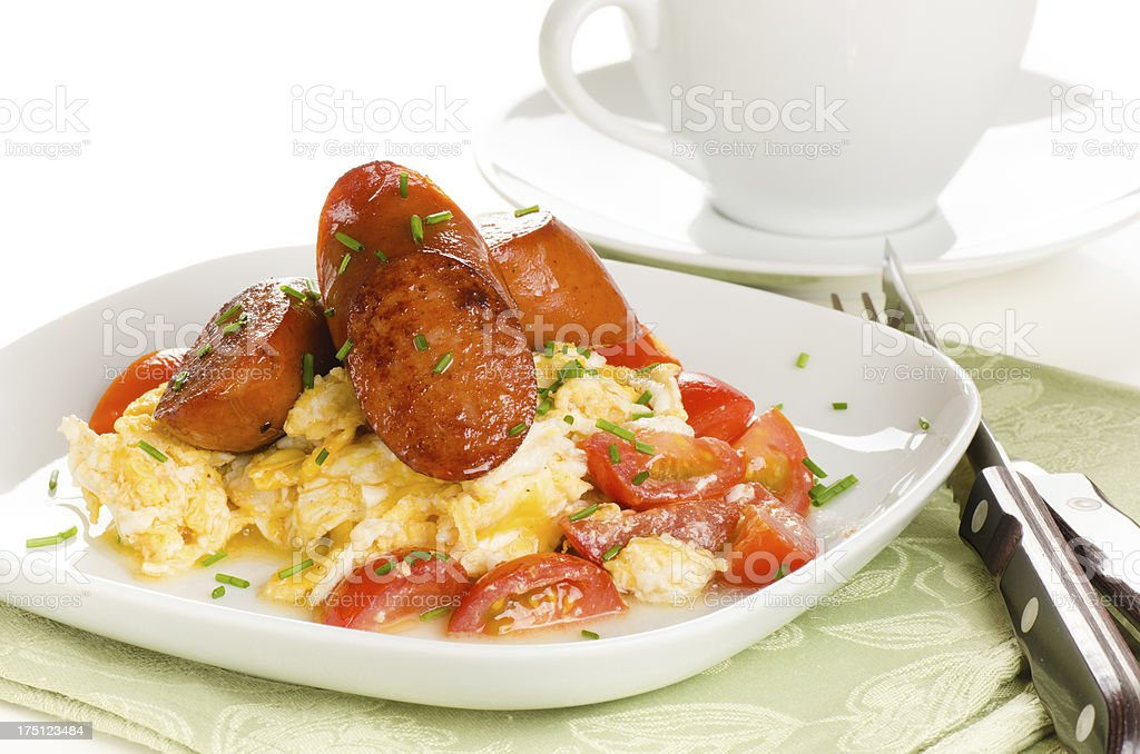 scrambled eggs with tomatoes and chorizo sausage royalty-free stock photo