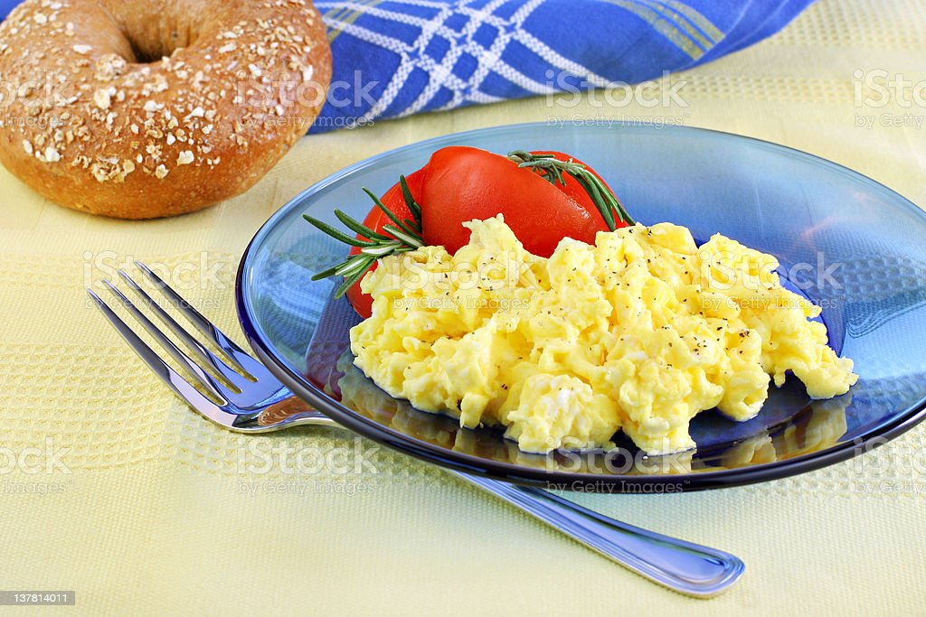 Scrambled eggs with tomatoes and fresh rosemary. royalty-free stock photo