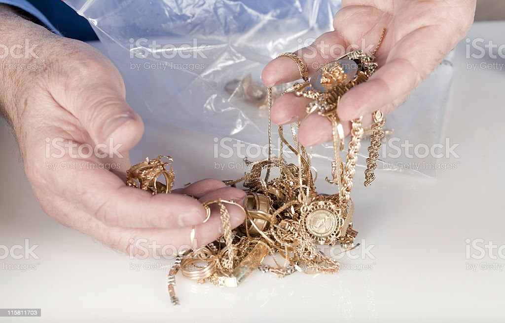 scrap gold being sold for cash stock photo