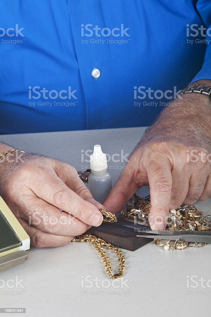 scrap gold for sale, Acid test stock photo
