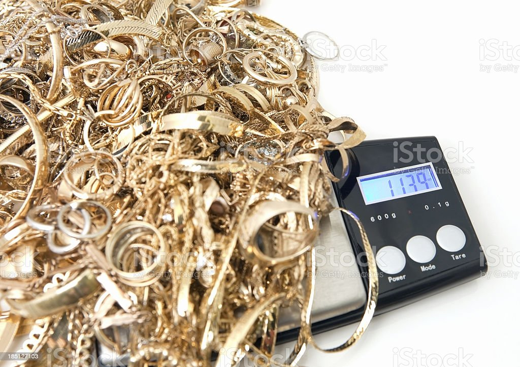 Scrap Gold on Jeweler's Scale royalty-free stock photo