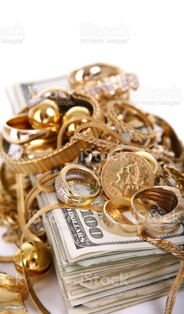 Scrap Gold on Stack of Cash royalty-free stock photo