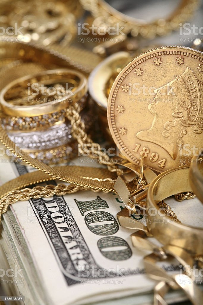 Scrap Gold on top of a Cash Stack royalty-free stock photo