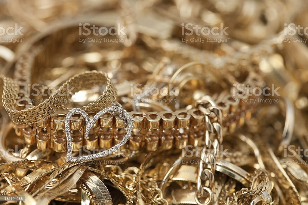 Scrap Gold Pile Background with Heart stock photo