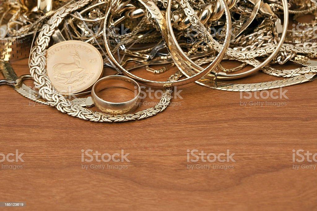 Scrap Gold Pile On Cherry Wood stock photo