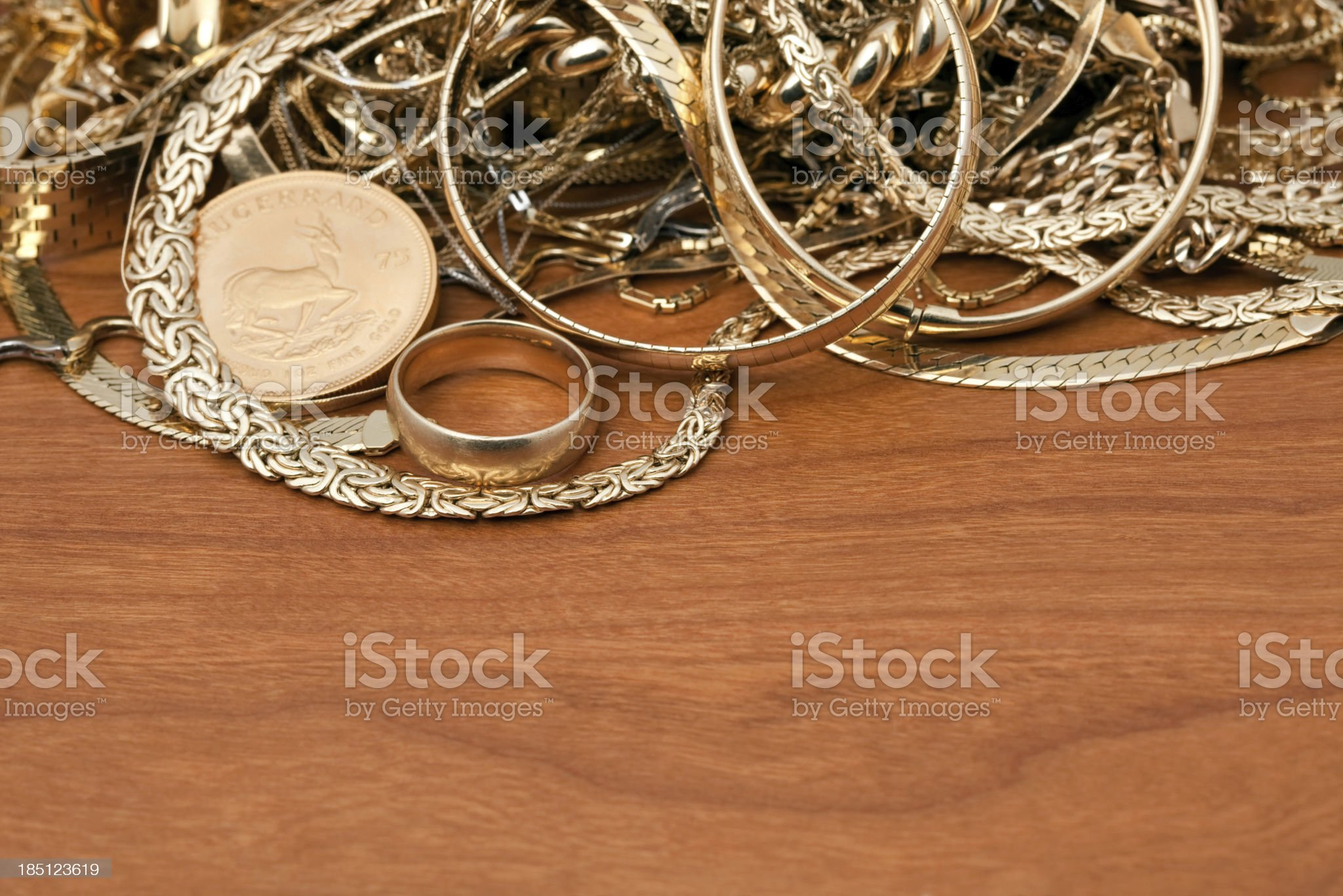 Scrap Gold Pile On Cherry Wood royalty-free stock photo
