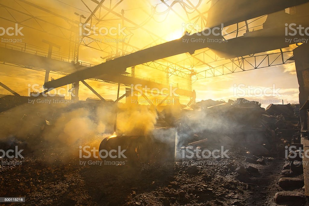 Scrap metal and smoke stock photo