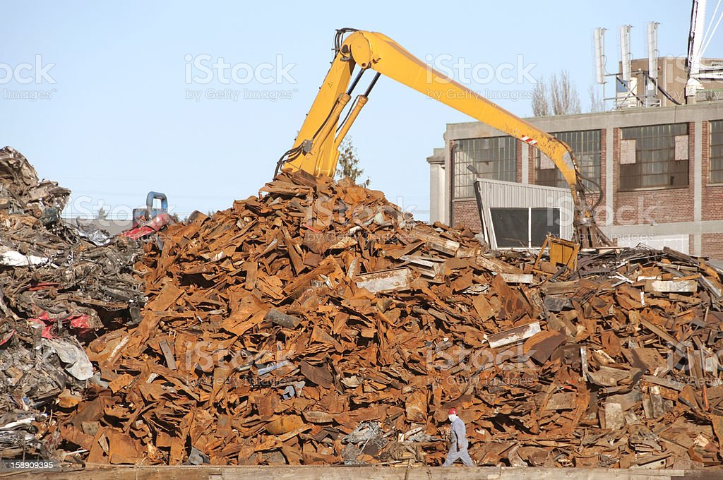 Scrap metal recycling plant and crane royalty-free stock photo
