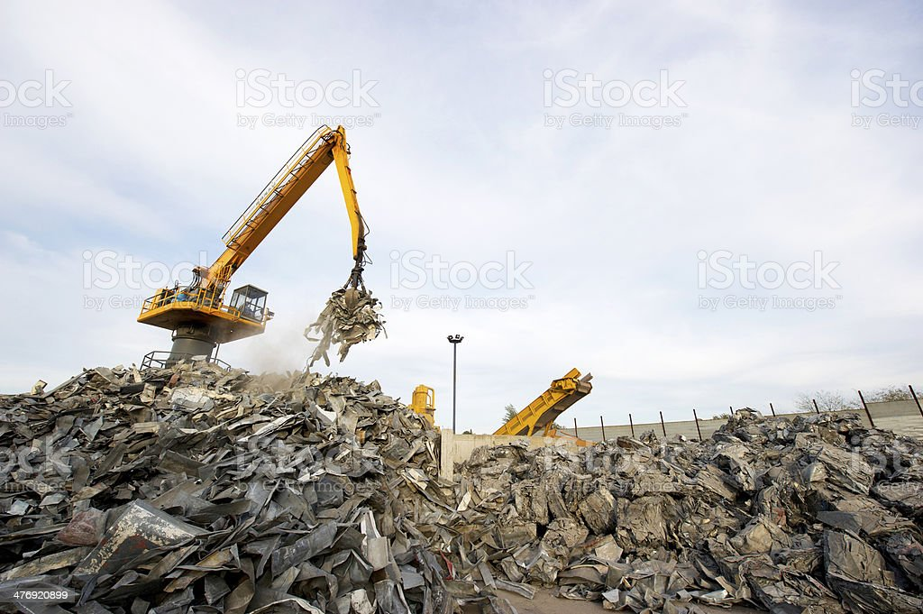 Scrap metal recycling plant and crane stock photo