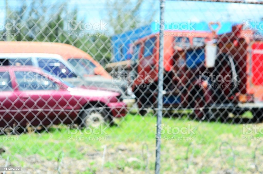 scrap yard of automobiles put out to pasture stock photo