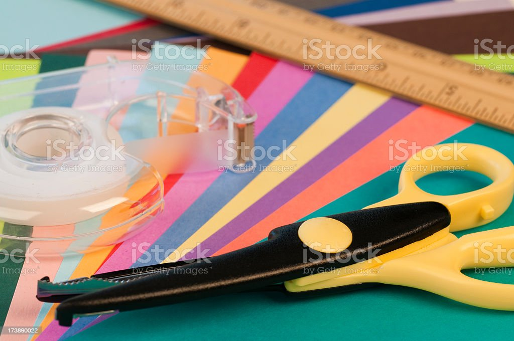 Scrapbooking tools including paper, scissors, and tape royalty-free stock photo