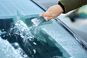 Scraping Ice Off the Windshield