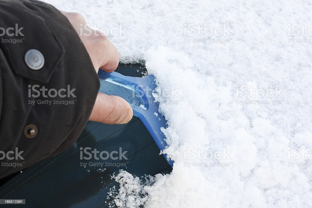 Scraping ice off Windscreen royalty-free stock photo
