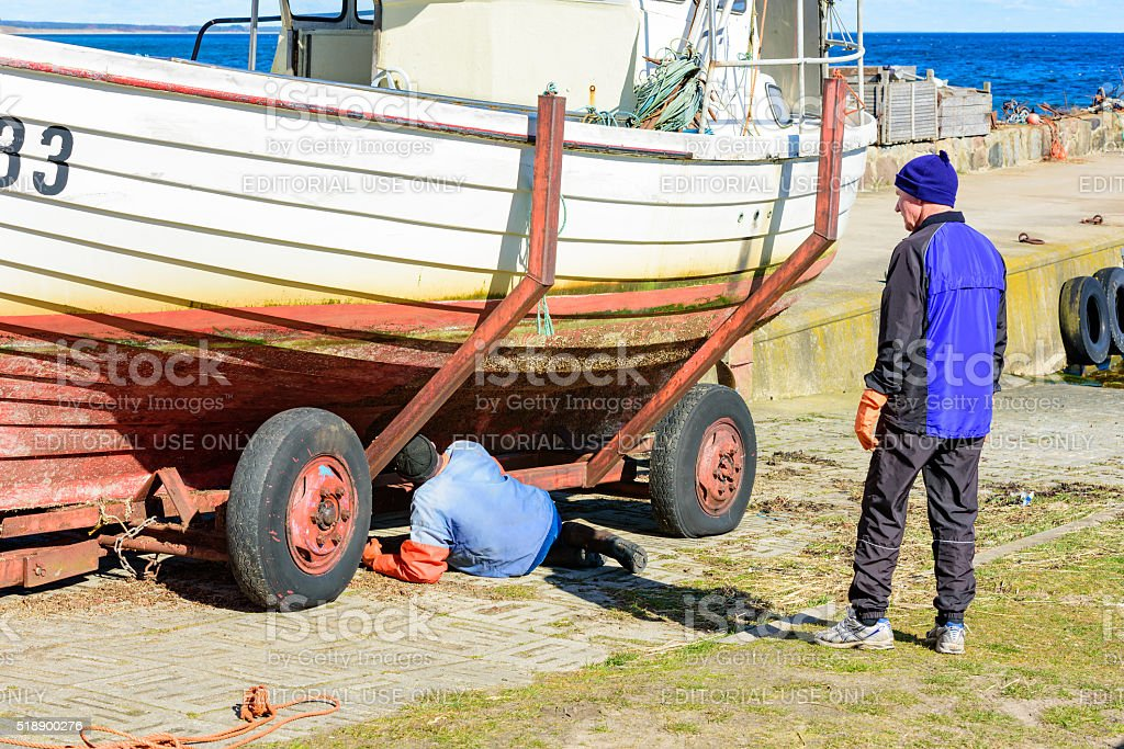 Scraping of barnacles stock photo