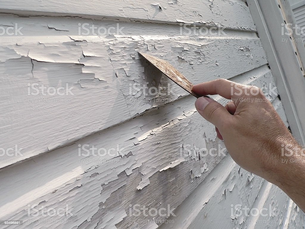 Scraping Peeling Paint stock photo