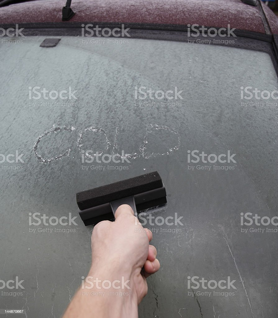 Scraping the windshield royalty-free stock photo