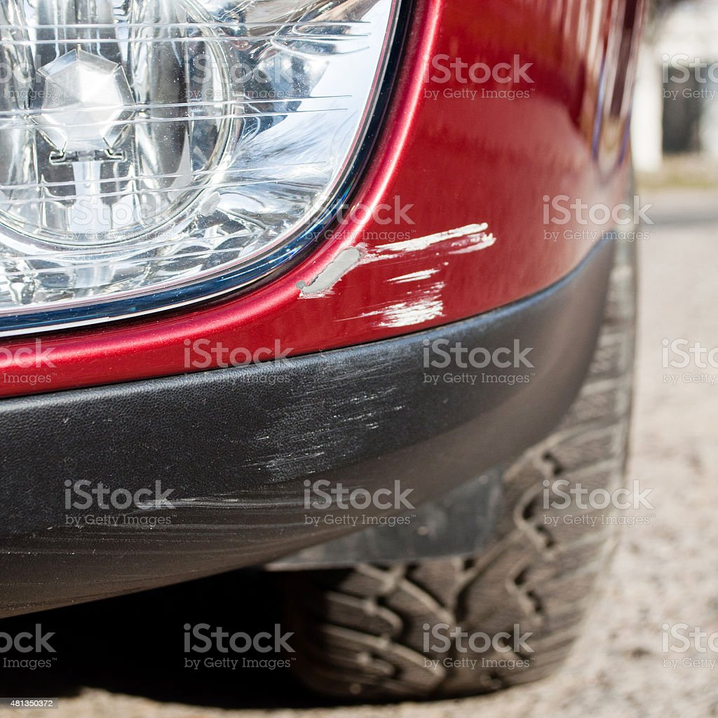 Scratch on a car's bumper - under the headlight stock photo