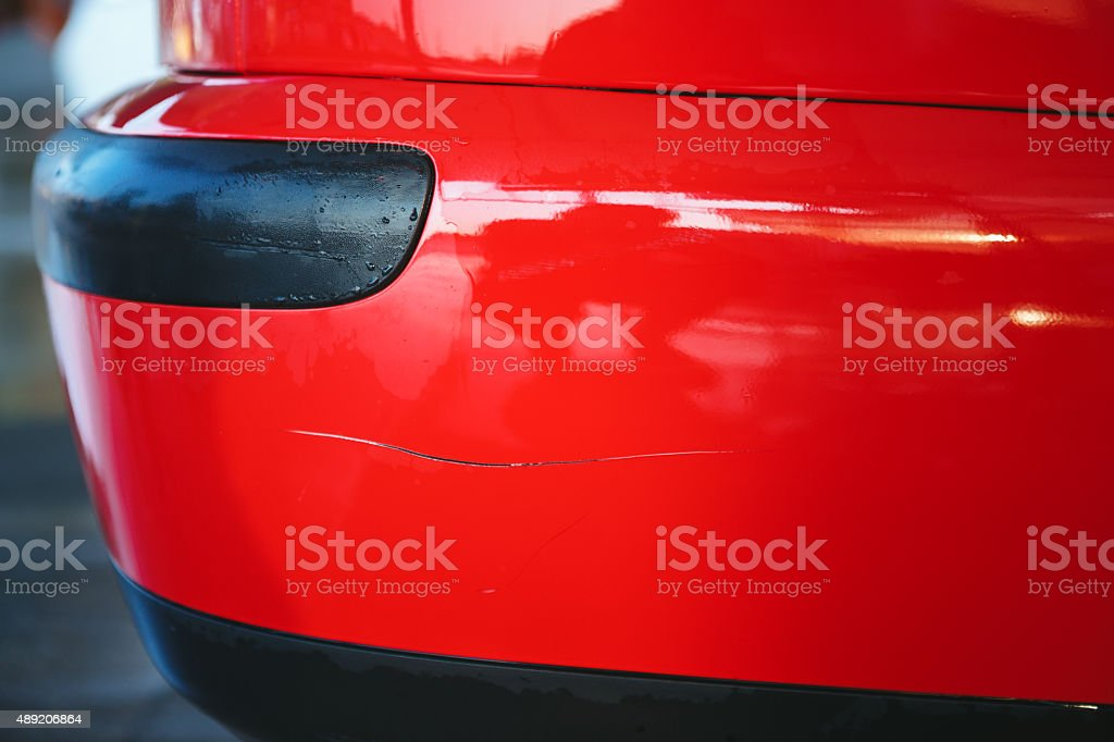 Scratche on a red car stock photo