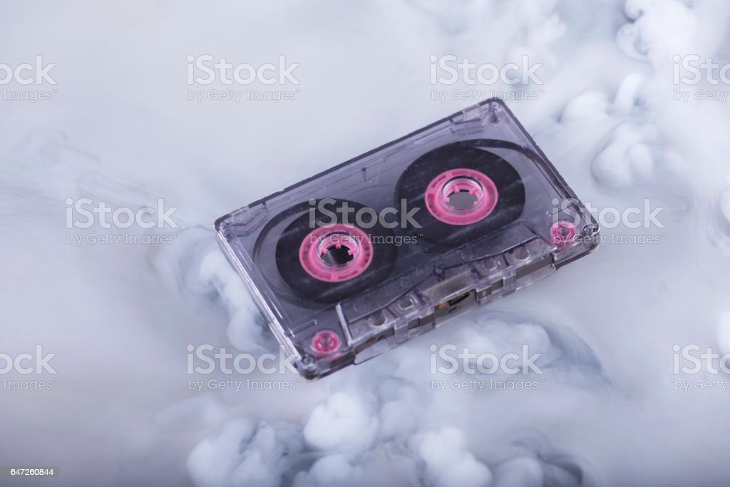 Scratched and dirty retro cassette tape. Conceptual photography stock photo