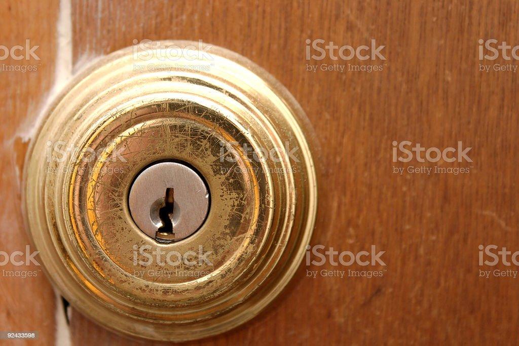 Scratched, Brass Door Lock - Close-Up stock photo