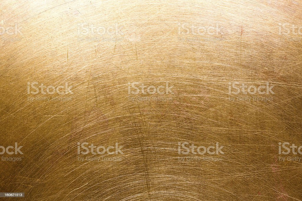 Scratched brass metal surface royalty-free stock photo