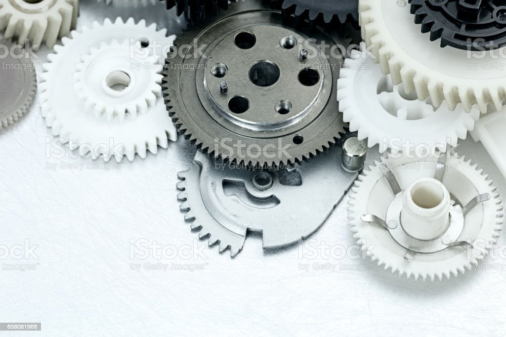 scratched metal industrial background with plastic gears. industrial equipment. stock photo