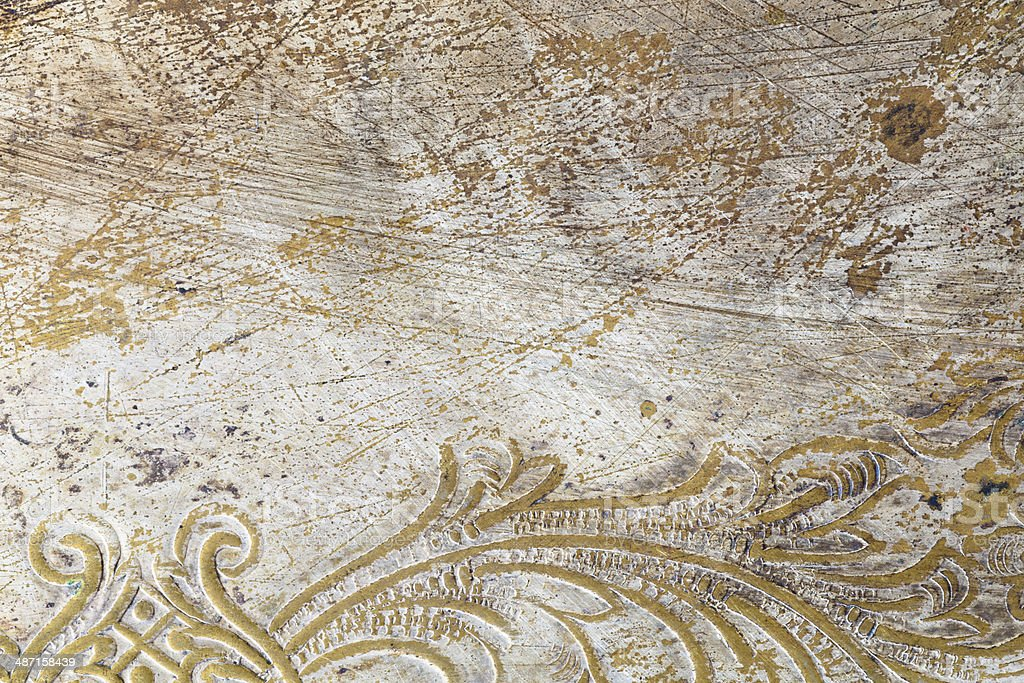 Scratched Metal with Ornamental Design royalty-free stock photo