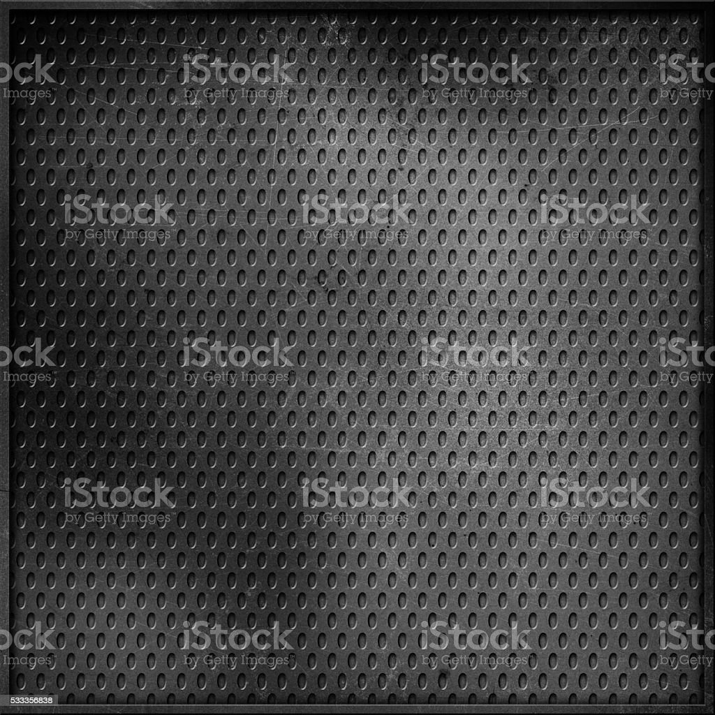 Scratched perforated metal background stock photo