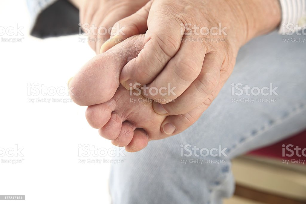 scratching bottom of foot stock photo