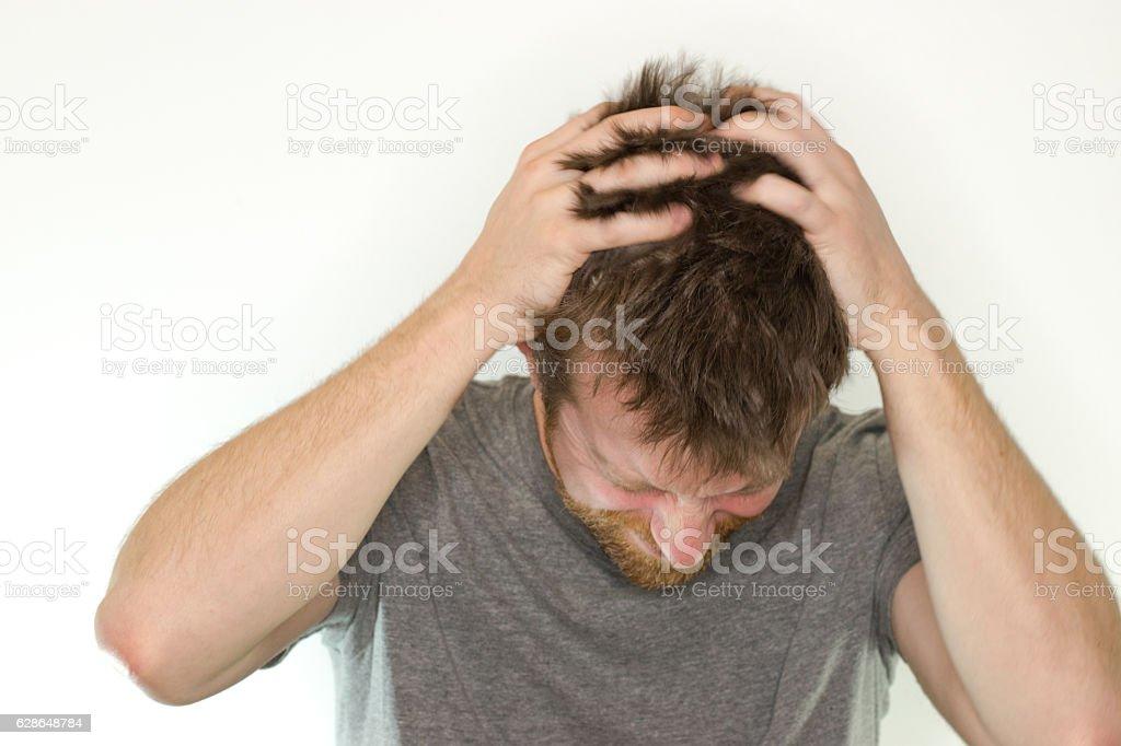 scratching head man stock photo