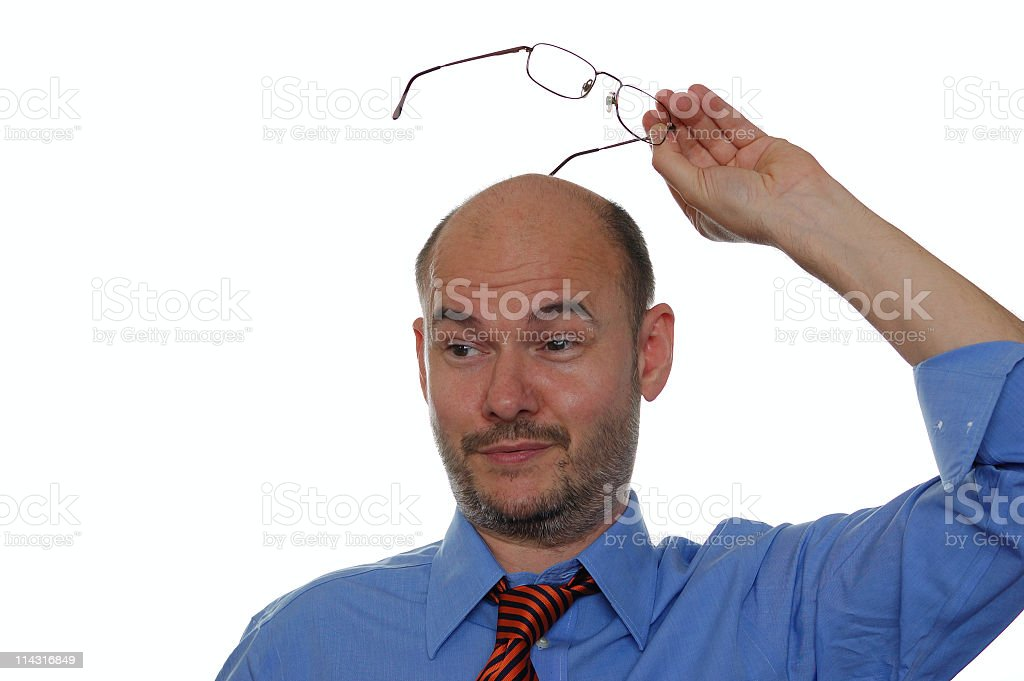 Scratching Head with Glasses royalty-free stock photo