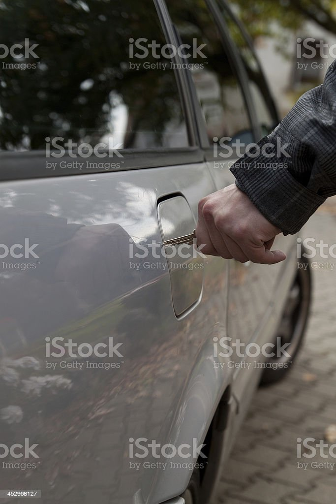 scratching the car stock photo