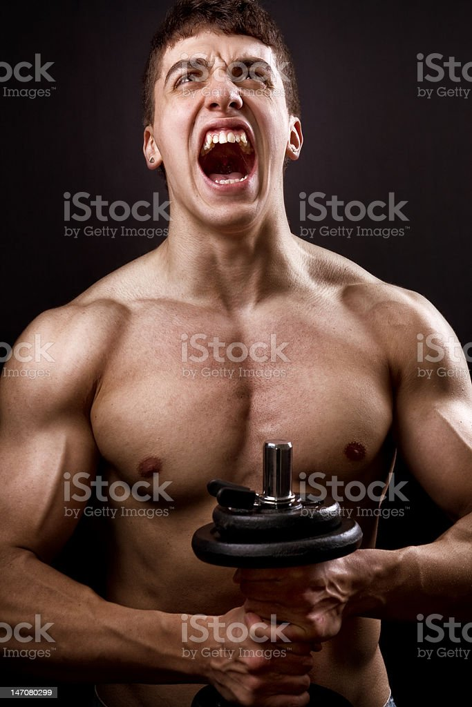 Scream of powerful muscular bodybuilder royalty-free stock photo