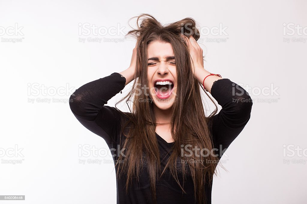 Scream young girl on white background stock photo