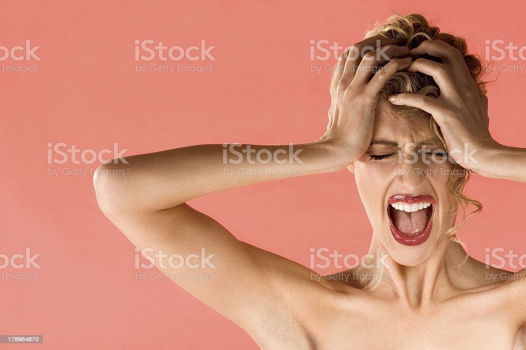 Screaming blond beautiful woman with shut eyes royalty-free stock photo