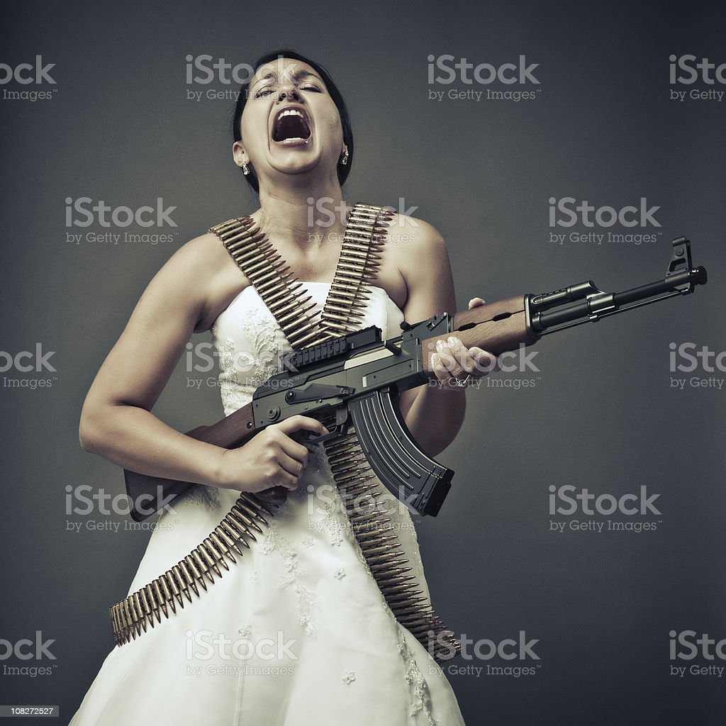 screaming bride with an ak-47 stock photo
