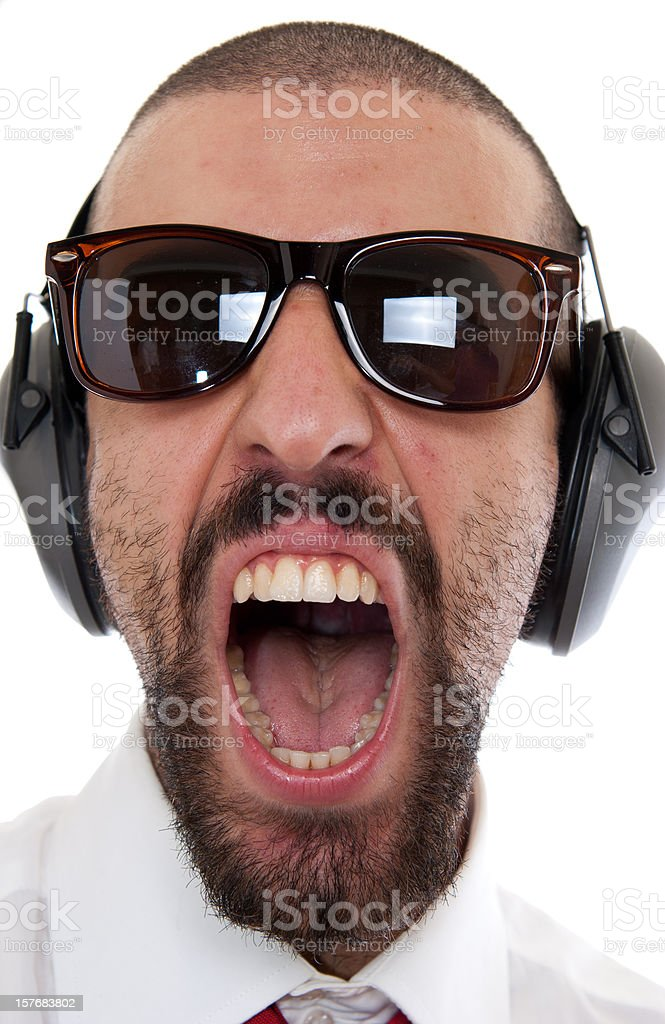 Screaming Business man listening music and singing stock photo