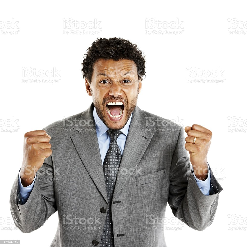Screaming businessman holding up his fists royalty-free stock photo