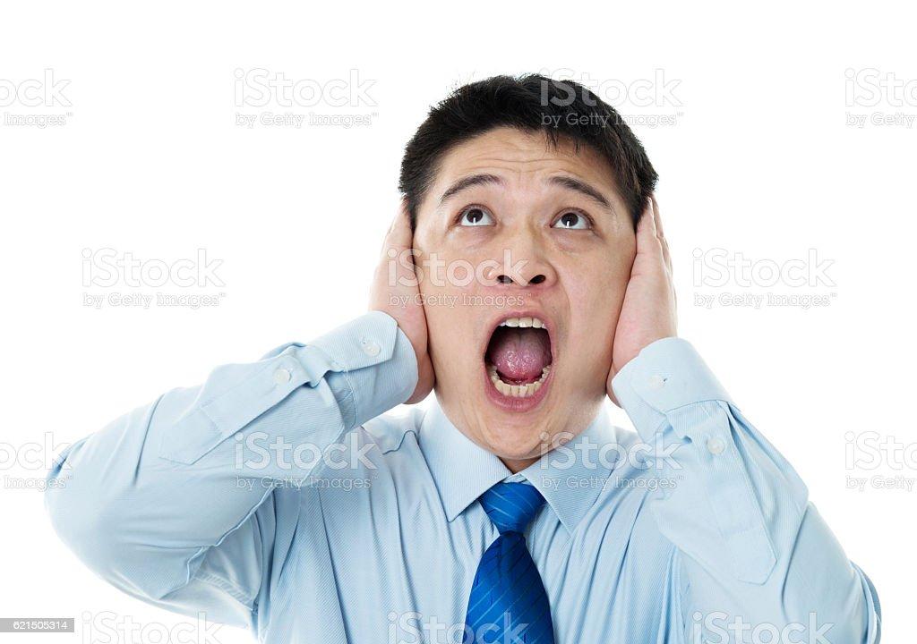 Screaming businessman isolated on white background stock photo
