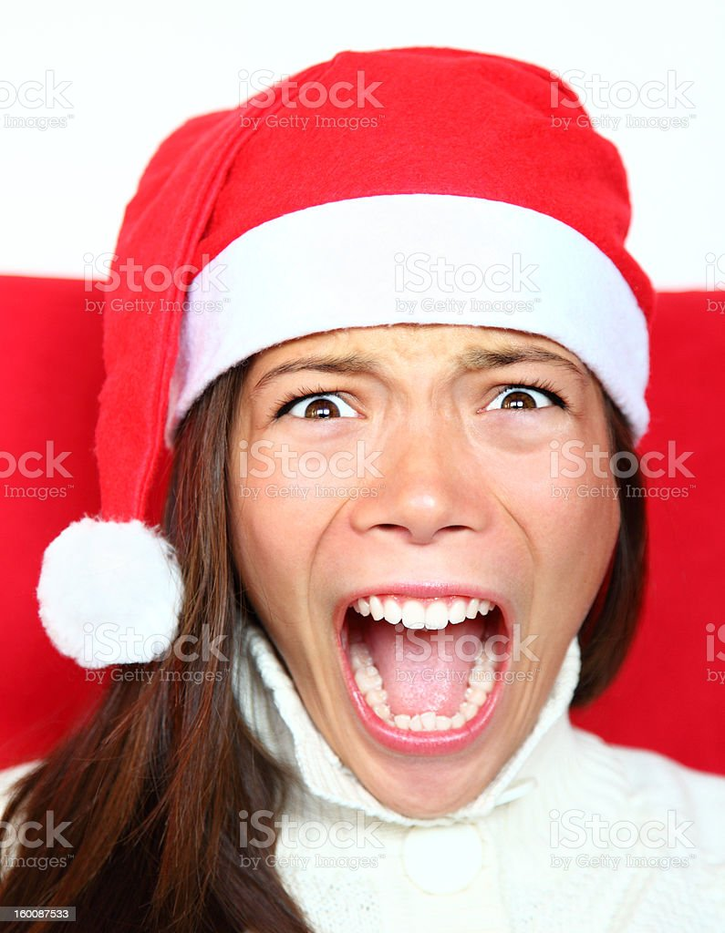 Screaming christmas woman with stress stock photo