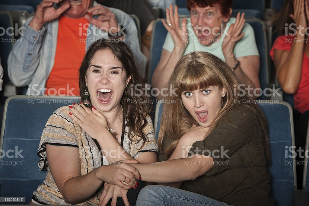 Screaming Friends in Theater royalty-free stock photo