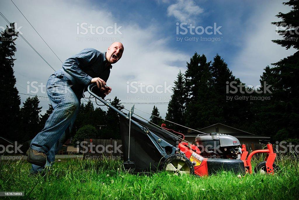 Screaming gardener man pushing a red lawn mower stock photo