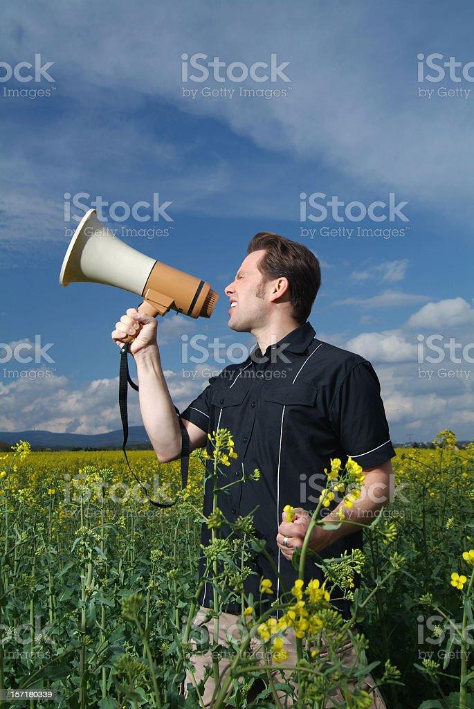 screaming into megaphone stock photo