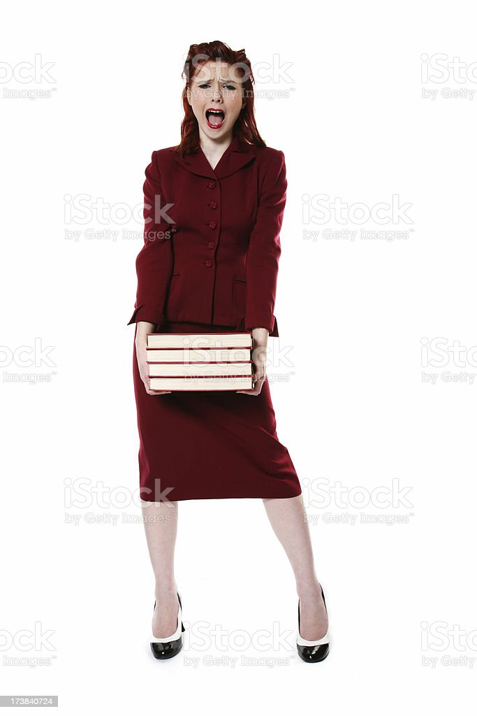 Screaming retro woman with heavy books royalty-free stock photo