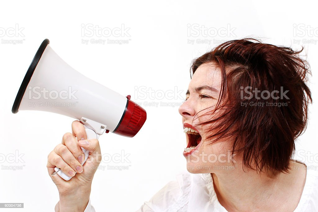 Screaming woman with megaphone stock photo
