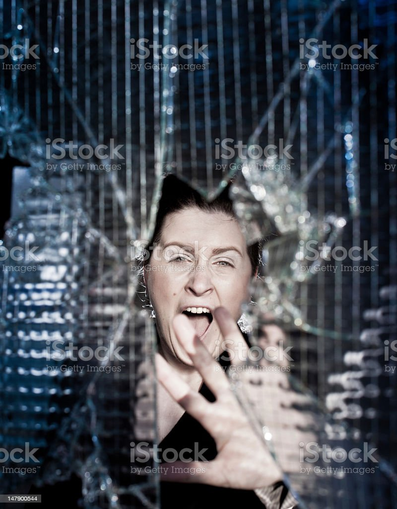 Screaming young woman by the window stock photo
