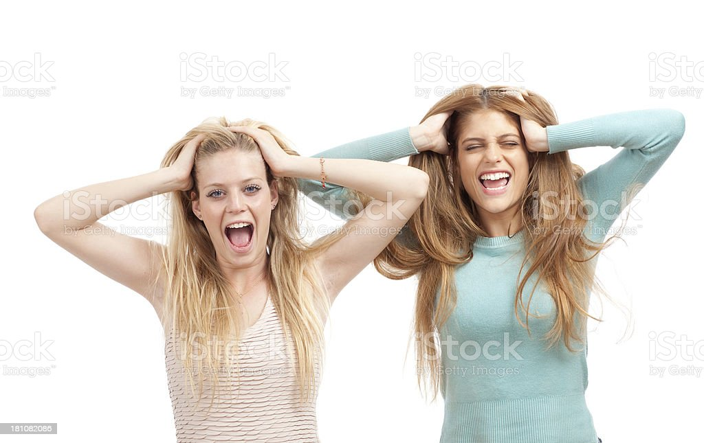 Screaming young women pulling out hair. royalty-free stock photo