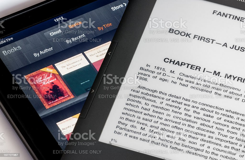 Screen comparison of Kindle Fire table and Keyboard ebook stock photo