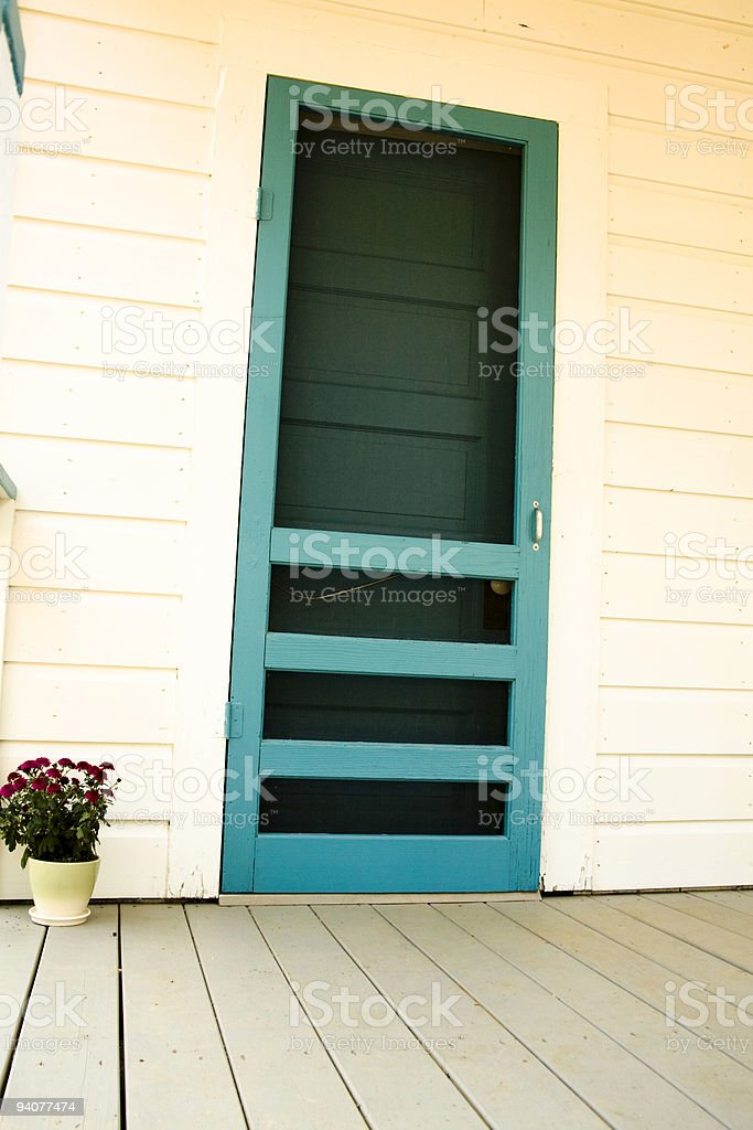 Screen door of old farm house. royalty-free stock photo
